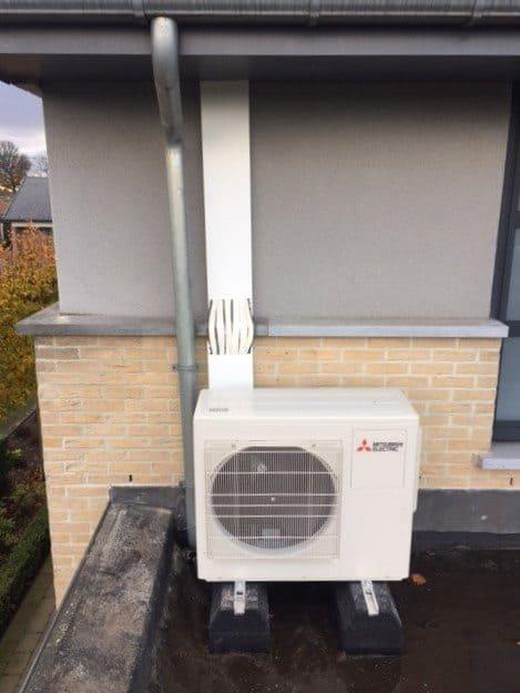 buitenunit warmtepomp op plat dak
